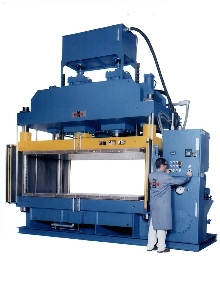 Molding Press compresses composite materials.
