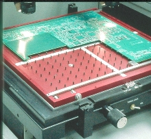 Substrate Support System holds up printed circuit board.