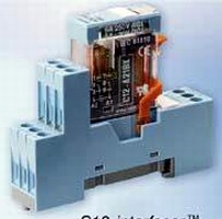 Plug-In Relay links PC or PLC logic to machine operation.
