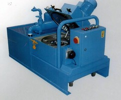 Centrifuge removes fine grinding solids from coolants/oils.