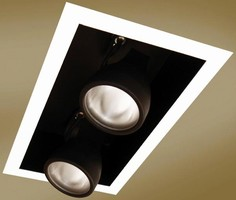 Lighting fixtures combine track and recessed styles delivering clean uncluttered look for retail environments multiple semi recessed adjustables deliver aiming flexibility of track lighting with look of mozeypictures Choice Image