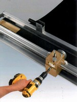 Portable Roller Lacer speeds installation of wire hooks.