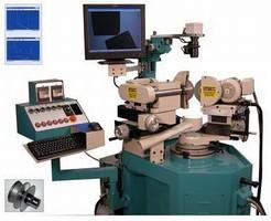 Machine performs diamond/CBN wheel truing and dressing.