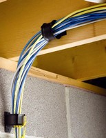 Cable Retainer facilitates cable run direction changes.