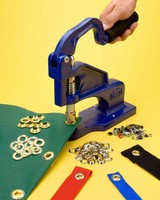Hand Press allows flexible placement of metal grommets.