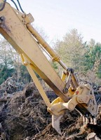 Multifunctional Stump Harvester offers one-man operation.