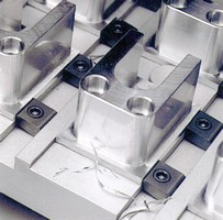 Fixture Clamp provides positive down force.