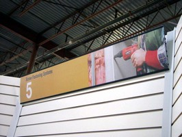 Signboards draw attention to tradeshow booths.