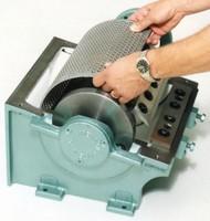 Swarf Handling System granulates and removes lens waste.