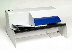 Automatic Letter Opener handles 32,000 envelopes/hr.