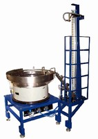 Vibratory Bowl Feeders feed engine valves using 2 outlets.