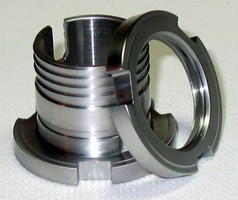 Mount connects ball bearings to shaft.