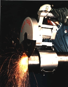 Abrasive Saw cuts pipe up to 5 ft in diameter.