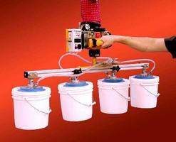 Vacuum Lifter speeds handling of pails.