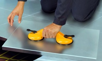 Hand Vacuum Lifter handles loads safely using suction cups.
