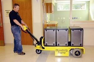 Motorized Cart hauls equipment, materials, and parts.
