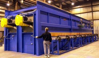 Gas-Fired Conveyor Oven preheats tubes for oil industry.