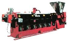Extruder reprocesses low bulk density foam.