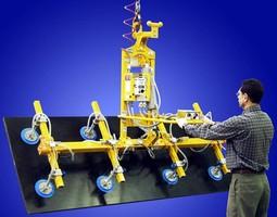 Vacuum Lifter-Tilter lets one person handle 2,000 lb panel.