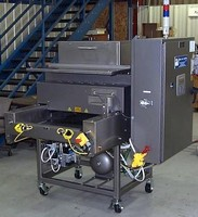 Large Platen Press uses heat to seal medical packaging.