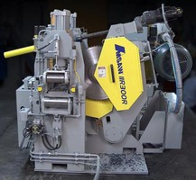 Combined Saw/Drill cuts rails for railroad industry.