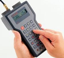 Digital Handheld Calibrator measures pressure, temperature.