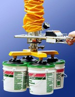 Vacuum Tube Lifter simultaneously handles four 5 gal pails.