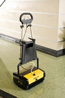 Floor Scrubber cleans hard surfaces and carpets.