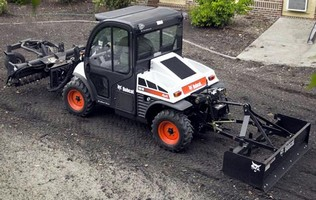 Utility Work Machine has 3-point hitch, PTO, front lift arm.