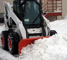Heavy-Duty Attachments facilitate snow removal.