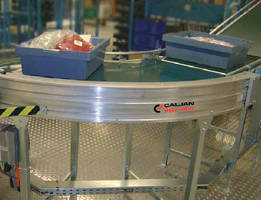 Belt Conveyor moves loads through curves to next conveyor.