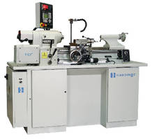 Lathe features electronic servo motor and threading computer.