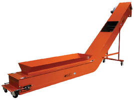 Conveyor efficiently handles light, fluffy fiber materials.