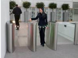 Optical Turnstile has illuminated pivoting angel wing doors.