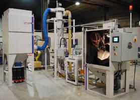 Tumble-Blast Machine pressure-blasts small components.