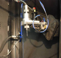 Robotic Shot Peener automatically changes tools.