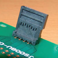 Card Reader mates vertically on PCB.
