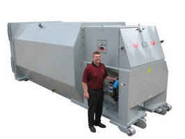 Self-Contained Auger Compactor processes wet and dry waste.