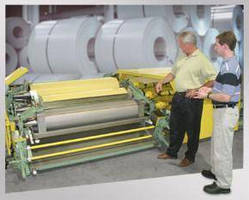 Vertical Roll Coater features space conserving design.