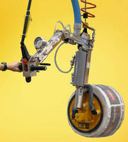 Vacuum Lifter-Tilter lifts and orients coiled products.