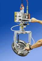 Vacuum Lifter handles compact metallic loads.