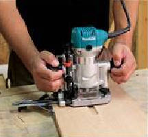 Compact Woodworking Router features 1 1/4 hp motor.