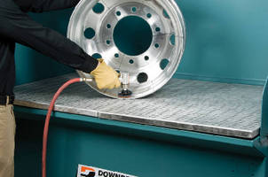 Downdraft Table captures metal grinding particles in water.