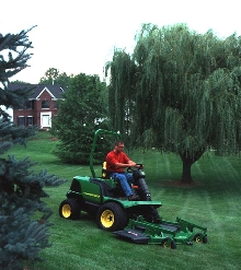 Front Mower has 36 hp motor for 15 mph transportation.