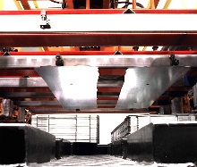 Sheet Metal Equipment destacks, feeds, conveys and washes.
