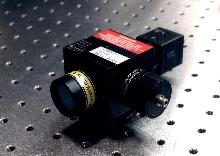Imaging System focuses laser onto work surface.
