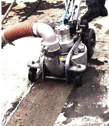 Pressure Cleaner uses water to remove floor coatings.
