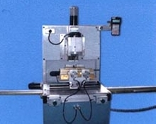 CNC Router includes automatic self-centering device.
