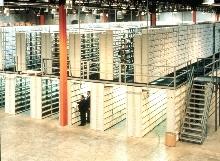 Shelving System integrates with mezzanine storage.