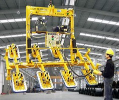 Vacuum Lifter features hydraulic powered tilter.